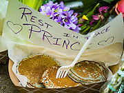 "22 APRIL 2016 - MINNEAPOLIS, MN: Pancakes left at a memorial for Prince in front of 1st Ave in Minneapolis. Prince was known to serve pancakes to guests at the all night dance parties in his Chanhassen home and ate pancakes during a guest appearance on the American TV show ""New Girl."" Thousands of people came to 1st Ave in Minneapolis Friday to mourn the death of Prince, whose full name is Prince Rogers Nelson. 1st Ave is the nightclub the musical icon made famous in his semi autobiographical movie ""Purple Rain."" Prince, 57 years old, died Thursday, April 21, 2016, at Paisley Park, his home, office and recording complex in Chanhassen, MN.    PHOTO BY JACK KURTZ"