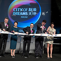 MACAU, CHINA - JUNE 01:  Businessman James Packer (2ndR) wife Erica Baxter (R), CEO of Melco Entertainment Lawrence Ho (C) wife Sharen Ho and President of 'City of Dreams' Greg Hawkins (L) cut a ribbon during the opening of Packer and Ho's 'City of Dreams' casino on June 1, 2009 in Cotai, Macau. The new 420,000 square foot casino, built on marshland 9km from Macao's traditional casino district but over the road from the world's largest casino 'Sands Venetian Macao', hopes to lure customers to the new casino area. 'City of Dreams' will offer over 500 gambling tables alongside its 3 hotels, a shopping mall and digital fish which swim in an electronic aquarium know as 'The Bubble'.  Photo by Victor Fraile / studioEAST
