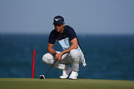 Adrien Saddier (FRA) on the 18th green during Round 4 of the Oman Open 2020 at the Al Mouj Golf Club, Muscat, Oman . 01/03/2020<br /> Picture: Golffile | Thos Caffrey<br /> <br /> <br /> All photo usage must carry mandatory copyright credit (© Golffile | Thos Caffrey)