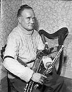 "Leo Rowsome.29/02/1959..Leo Rowsome (05/04/1903 – 20/09/1970) was the third generation of an unbroken line of uilleann pipers. He was performer, manufacturer and teacher of the uilleann pipes - the complete master of his instrument. He devoted his entire life to the uilleann pipes..Samuel Rowsome, Leo's grandfather sent his sons, John, Thomas and William to a German teacher of music who resided in Ferns, near their home in Co. Wexford to learn the theory of music and how to play various instruments. This knowledge was passed on through William to his son, Leo who made good use of it in his teaching, writing music for his many pupils..Leo was born in Harold's Cross, Dublin in 1903. His father, William realised that his son had the ability to become a talented musician and craftsman. Constantly watching his father making and repairing instruments, Leo learned the art of pipe making and instrument repair. So rapid was his progress at piping that in 1919 at the age of sixteen he was appointed teacher of the uilleann pipes at Dublin's Municipal School of Music (now D.I.T. Conservatory of Music & Drama) for 50 years. He also taught at Dublin's Pipers Club of which he was President..Leo was the first uilleann piper to perform on Irish National Radio in the early 1920s when he played solo and later in duets with Frank O'Higgins (fiddle), Micheal O Duinn (fiddle) and Leo's brother John (fiddle). Leo's ""All Ireland Trio"" comprised Neilus Cronin, flute, Seamus O'Mahony, fiddle and Leo pipes. He formed his Pipes Quartet in the mid 1930s and broadcast regularly throughout the 1940s/50s. Leo was the first Irish artist to perform on BBC T.V. (1933). He made many recordings for Decca, Columbia and HMV. His last commercial recording, CC1 ""Ri na bPiobairi"" (King of the Pipers) was made for Claddagh Records in 1966..Leo Rowsome died suddenly whilst adjudicating 'The Fiddler of Dooney Competition' in Riverstown, Co. Sligo on 20 September 1970..."