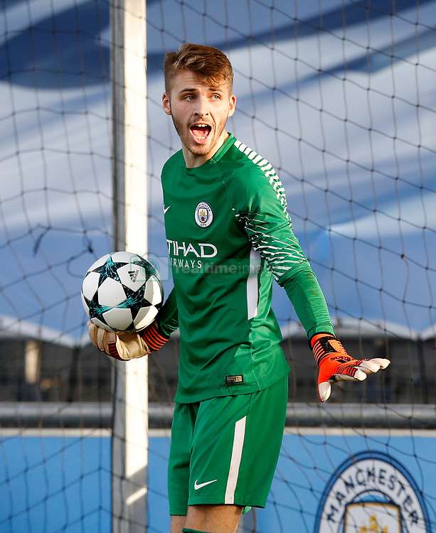 Manchester City's goalkeeper Daniel Grimshaw reacts