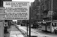 "Early 1970s, Berlin, Germany --- A sign near Check Point Charlie in Berlin, Germany  states that ""you are entering the American sector"" in Russian, English and French. --- Image by © Owen Franken/CORBIS"
