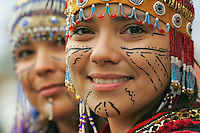 Sophia Chya and Serenity Schmidt, with traditional Alutiiq headdresses and face tattoos, from the Alaska Native Heritage Center.