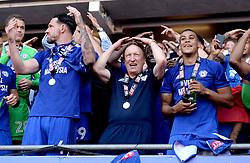 Cardiff City manager Neil Warnock (centre) and the Cardiff City players celebrate winning their promotion to the Premier League after the Sky Bet Championship match at the Cardiff City Stadium.