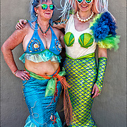 Mermaid Parade marchers wearing colorful  mermaid costumes  before the start of the parade in Coney Island.