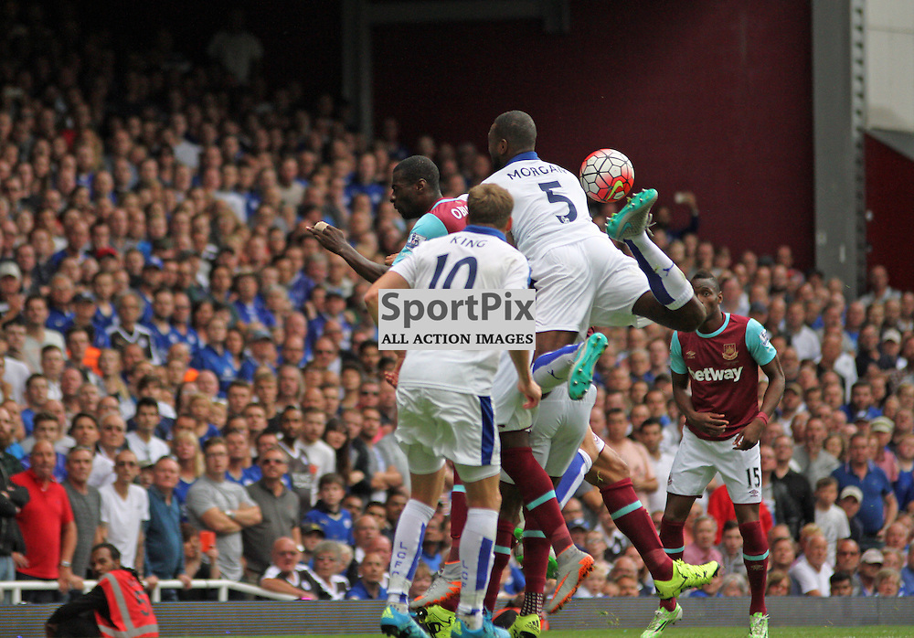 Wes Morgan attempts to kick the ball with the underneath of his boot at a corner During West Ham United vs Leicester City on Saturday the 16th August 2015.