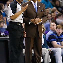 January 19, 2011; New Orleans, LA, USA; Memphis Grizzlies head coach Lionel Hollins talks with referee Tony Brothers (25) during the second quarter at the New Orleans Arena.   Mandatory Credit: Derick E. Hingle