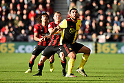 Troy Deeney (9) of Watford battles for position with Ryan Fraser (24) of AFC Bournemouth during the Premier League match between Bournemouth and Watford at the Vitality Stadium, Bournemouth, England on 12 January 2020.