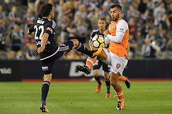 November 11, 2017 - Melbourne, Victoria, Australia - STEFAN NIGRO (22) of the Victory and PETROS SKAPETIS (33) of Brisbane compete for the ball in the round six match of the A-League between Melbourne Victory and Brisbane Roar at Etihad Stadium, Melbourne, Australia. Melbourne drew 1-1 (Credit Image: © Sydney Low via ZUMA Wire)