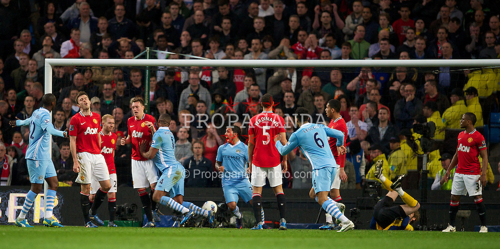MANCHESTER, ENGLAND - Monday, April 30, 2012: Manchester City's Vincent Kompany celebrates scoring the first goal against Manchester United during the Premiership match at the City of Manchester Stadium. (Pic by David Rawcliffe/Propaganda)