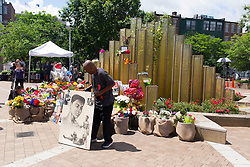 Michael Cowden lays a portrait of Muhammad Ali outside a make-shift memorial at the Muhammad Ali Center, Sunday, June 05, 2016.<br /> <br /> Legendary heavyweight boxing champion Muhammad Ali, a Louisville, Ky. native, died Friday, June 3, 2016. Murals and tributes could be seen across his hometown as people mourned the charismatic sports figure.