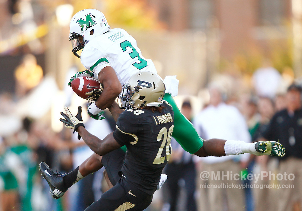 WEST LAFAYETTE, IN - SEPTEMBER 29: Aaron Dobson #3 of the Marshall Thundering Herd and Josh Johnson #28 of the Purdue Boilermakers battle for a pass that fell incomplete at Ross-Ade Stadium on September 29, 2012 in West Lafayette, Indiana. (Photo by Michael Hickey/Getty Images) *** Local Caption *** Aaron Dobson; Josh Johnson