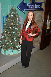 OLIVIA GRANT at the official opening of the 2014 Tiffany & Co.Christmas Shop on Bond Street, London on 16th November 2014.