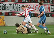 n/z.: (L) bramkarz Krzysztof Kotorowski (Lech) fauluje w polu karnym & (R) Marcin Bojarski (Cracovia) podczas meczu ligowego Cracovia Krakow - Lech Poznan , I liga 19 kolejka sezon 2006/2007, Orange Ekstraklasa , pilka nozna , Polska , Krakow , 30-03-2007 , fot.: Adam Nurkiewicz / mediasport..(L) goalkeeper Krzysztof Kotorowski (Lech) fouls in penalty area & Marcin Bojarski (Cracovia) during soccer first division league match between Cracovia Cracow and Lech Poznan in Cracow, Poland. March 30, 2007 ; 19 round season 2006/2007 , football , Poland , Cracow ( Photo by Adam Nurkiewicz / mediasport )