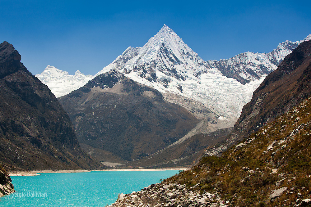 Paria Peak (5,600m/18,368ft) (L) and Piramide Peak (5885m/19,303ft) (R) at the end of the Lago Paron Cirque in the Cordillera Blanca mountain range in Central Peru.