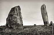 A family grouping of three stones at the Avebury Standing Stones site in Wiltshire, England.
