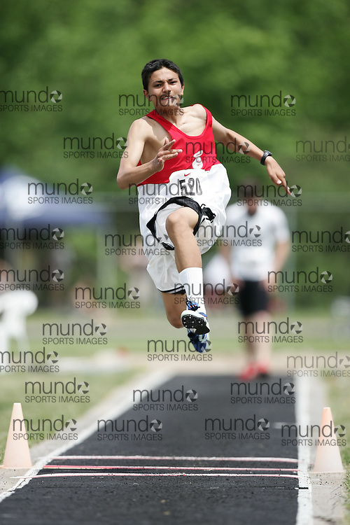 Hamilton, Ontario ---07/06/08--- Mustafa Qayoumi of Eastern Commerce in Toronto competes in the triple jump at the 2008 OFSAA Track and Field meet in Hamilton, Ontario..GEOFF ROBINS