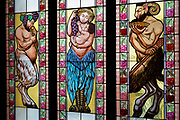 Contemporary stained glass windows by V Stanek and J Sebek featuring cherubs in a garden on the upper floor of the Lucerna Cinema, on 19th March, 2018, in Prague, the Czech Republic. The most elegant of Nove Mesto's many shopping arcades runs through the art-nouveau Lucerna Palace (1920), between Stepanska and Vodickova streets. The complex was designed by Vaclav Havel (grandfather of the former president), and is still partially owned by the family. It includes theatres, a cinema, shops, a rock club and several cafes and restaurants.