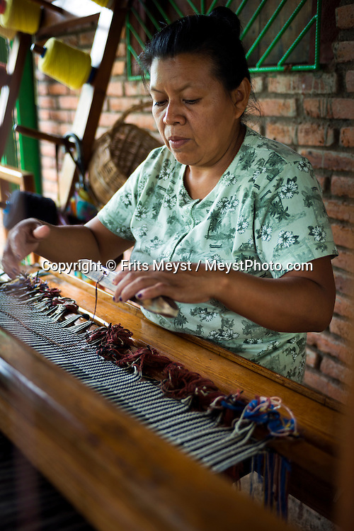 Matagalpa, Nicaragua, May 2014. An indigineous woman of the El Chile weaving cooperative. Matagalpa tours offers trips to coffee plantations and remote villages, rural community tourism, agro-tourism, hiking and biking. Central America's largest and least populated country consists of lakes; volcanoes and Spanish colonial cities. Photo by Frits Meyst / MeystPhoto.com