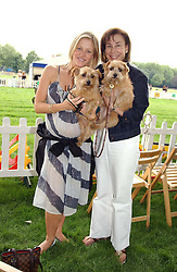 Left to right, HELEN WRIGHT and DEBORAH BENNETT with her dogs Clicquot and Tattinger at the Macmillan Cancer Relief Dog Day held at the Royal Hospital Chelsea South Grounds, London on 6th July 2004.