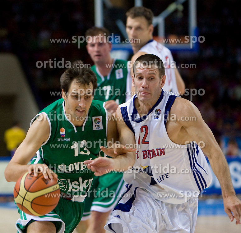 Domen Lorbek (13) of Slovenia vs Nate Reinking of Great Britain during the basketball match at 1st Round of Eurobasket 2009 in Group C between Slovenia and Great Britain, on September 07, 2009 in Arena Torwar, Warsaw, Poland. (Photo by Vid Ponikvar / Sportida)