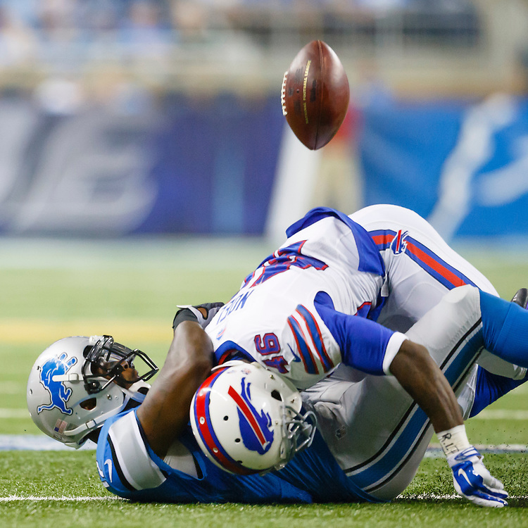 Buffalo Bills cornerback Merrill Noel (46) tackles Detroit Lions wide receiver Jeremy Ross (12) cuasing a fumble in the first half of an preseason NFL football game at Ford Field in Detroit, Thursday, Sept. 3, 2015. (AP Photo/Rick Osentoski)
