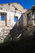 Derelict abandoned house ruin in ancient village of Old Perithia - Palea Peritheia - Northern Corfu, Greece