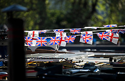 © Licensed to London News Pictures. 05/05/2018. London, UK. Union  and St Georges flag bunting on a boat as the Canalway Cavalcade festival takes place in Little Venice, West London on Saturday,  May 5th 2018. Inland Waterways Association's annual gathering of canal boats brings around 130 decorated boats together in Little Venice's canals on May bank holiday weekend. Photo credit: Ben Cawthra/LNP