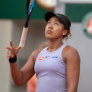 PARIS, FRANCE May 30.   Naomi Osaka of Japan juggles her racquet during her match against Victoria Azarenka of Belarus during the Women's Singles second round match on Court Suzanne Lenglen at the 2019 French Open Tennis Tournament at Roland Garros on May 30th 2019 in Paris, France. (Photo by Tim Clayton/Corbis via Getty Images)
