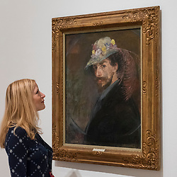 "© Licensed to London News Pictures. 25/10/2016. London, UK.  A staff member views ""Self-portrait with flowered hat, 1893"" at the preview of Intrigue: James Ensor by Luc Tuymans.  Curated by fellow Belgian artist Luc Tuymans, this is the first exhibition of work by modernist artist James Ensor (1860-1949) to be held in the UK in twenty years and will run 29 October 2016 to 29 January 2017. Photo credit : Stephen Chung/LNP"