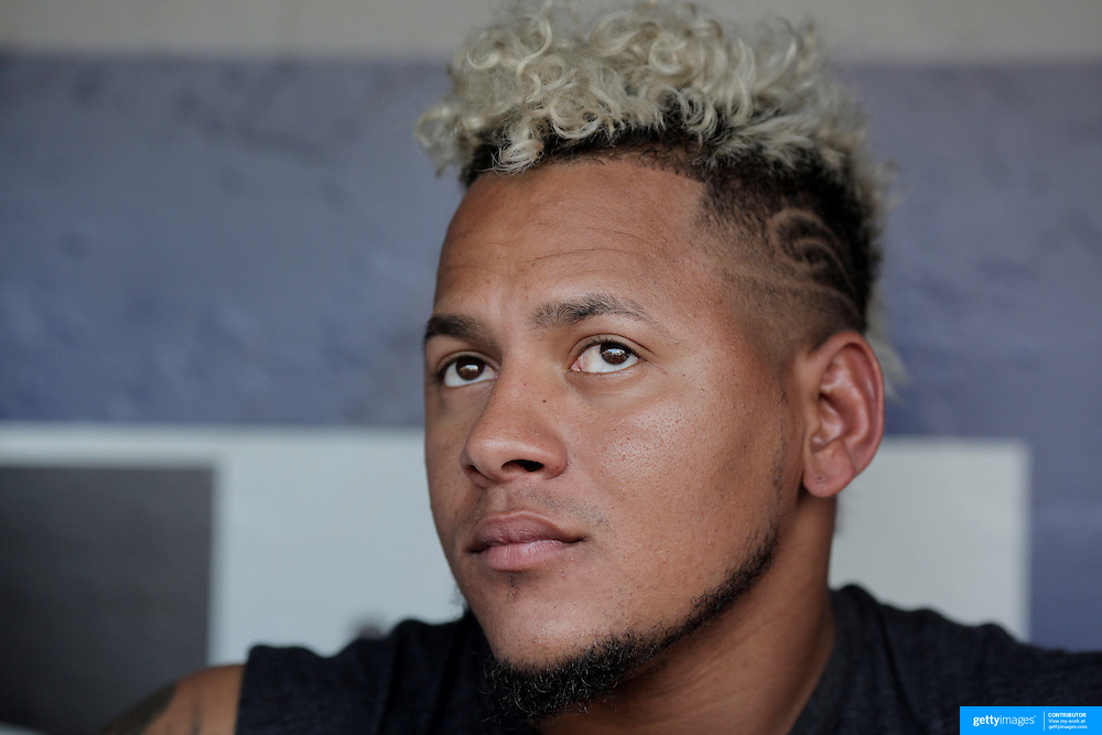 NEW YORK, NEW YORK - July 27: Pitcher Carlos Martinez #18 of the St. Louis Cardinals talking to the media in the dugout before the St. Louis Cardinals Vs New York Mets regular season MLB game at Citi Field on July 27, 2016 in New York City. (Photo by Tim Clayton/Corbis via Getty Images)