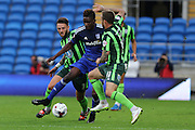 Sean Rigg of AFC Wimbledon and Callum Kennedy of AFC Wimbledon close down Sammy Ameobi during the Capital One Cup match between Cardiff City and AFC Wimbledon at the Cardiff City Stadium, Cardiff, Wales on 11 August 2015. Photo by Stuart Butcher.