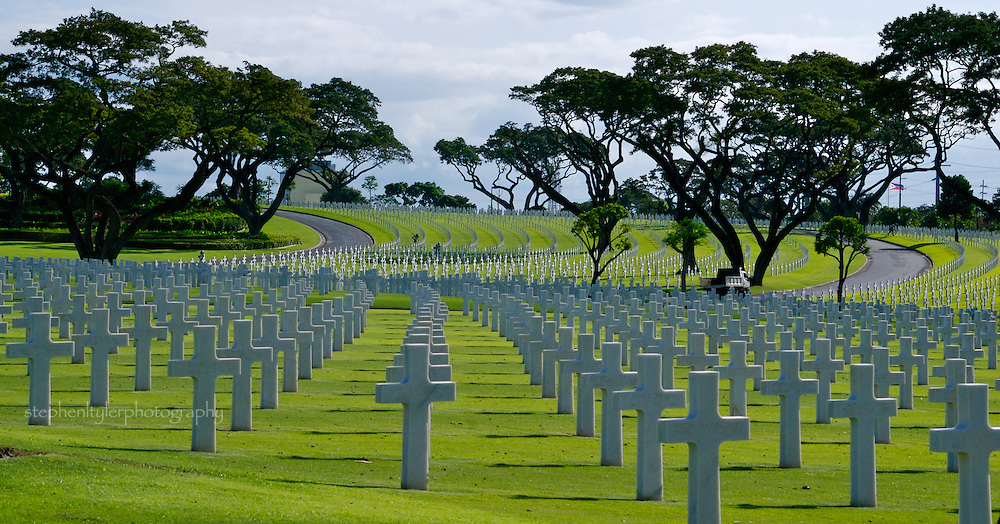 Manila American Cemetery & Memorial in Fort Bonifacio, The Philippines. The cemetery covers 152 acres and holds the remains of 16,636 US servicemen and 570 Filipinos who served with US Armed Forces; representing 40% of the burials originally made in temporary cemeteries in SW Pacific area.