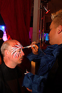 Jeff Clark of Beavercreek gets a painted mask applied by Jeremy Keith of Kettering during Masquerage 2011 in the Roundhouse at the Montgomery County Fairgrounds in Dayton, Saturday, October 15, 2011. Clark, who is here for his second time, said 'I asked for something scary and colorful and gave me this.'