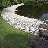 Momijiyama Garden is located near the ruins of Sunpu Castle in Shizuoka.  Garden of the Village is made up of various flowers, plants and a wooden pavilion. The zigzag wooden bridge is surrounded by irises in late May and June.  Garden of the Mountain Village is composed of a hill meant to resemble Mt. Fuji.  Surrounding the hill are azalea bushes arranged to as to look like the terraced tea fields of Shizuoka.  Shizuoka's claims to fame are green tea and Mt Fuji.  Next, Garden of the Sea or is meant to be viewed between the pines facing the pond with the white beach below, so as to resemble the seashore of Miwa. Stones in the pond and the opposite shore represent Izu coastline, also part of Shizuoka Prefecture and known for its seascapes.  Finally the Garden of the Mountain is composed of two small waterfalls meant to symbolize mountain scenes of Japan.