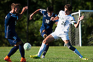 Burlington's Raushan Temirov (18) kicks the ball down the field during the boys soccer game between the The Burlington Seahorses and the Rice Green Knights at Rice Memorial high School on Tuesday afternoon September 15, 2015 in South Burlington, Vermont. (BRIAN JENKINS/for the FREE PRESS)