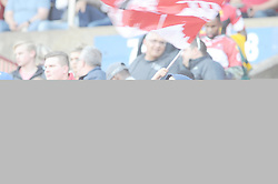 28-07-18 Emirates Airline Park, Johannesburg. Super Rugby semi-final Emirates Lions vs NSW Waratahs.  A young Lions fan waves a flag after the game after Lions beat the Waratahs to make it to the final<br />  Picture: Karen Sandison/African News Agency (ANA)