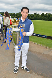 TOP SRIVADDHANAPRABHA holding the Premier League trophy at the Laureus King Power Cup polo match held at Ham Polo Club, Richmond on 16th June 2016.