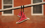 Shoes hang from utility wires in Bisbee, Arizona, USA.