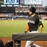 NEW YORK, NEW YORK - July 05: Giancarlo Stanton #27 of the Miami Marlins returns to the dugout after hitting a two run home run in the seventh inning during the Miami Marlins Vs New York Mets regular season MLB game at Citi Field on July 05, 2016 in New York City. (Photo by Tim Clayton/Corbis via Getty Images)