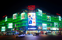 Modern Japanese owned Lotte department store at night in central Beijing China
