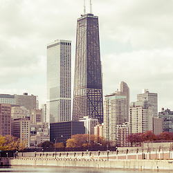 Chicago skyline vintage panorama photo with the John Hancock building and Lake Michigan shoreline. Picture has a vintage retro tone. Panoramic ratio is 1:3. Image Copyright © Paul Velgos All Rights Reserved.