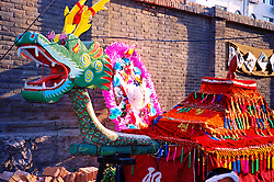 China, Shaanxi, 2007. An elaborate dragon float is made to accompany the spirit of a beloved grandmother toward heaven. .