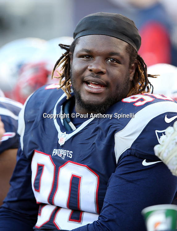 New England Patriots defensive tackle Malcom Brown (90) has a sideline chat with a teammate during the 2015 week 9 regular season NFL football game against the Washington Redskins on Sunday, Nov. 8, 2015 in Foxborough, Mass. The Patriots won the game 27-10. (©Paul Anthony Spinelli)