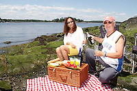 Alex Schibli with his wife Noelva Vigoya visit his island - Rat Island for a picnic on June 15, 2012