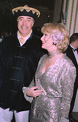 MR & MRS RUPERT HAMBRO members of the banking family, at a party in London on 27th January 1998.MEW 14