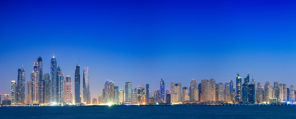 Night panorama view of many skyscrapers and apartment towers in Marina District in Dubai United Arab Emirates