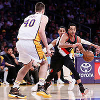 26 March 2016: Portland Trail Blazers guard CJ McCollum (3) drives past Los Angeles Lakers guard Jordan Clarkson (6) during the Portland Trail Blazers 97-81 victory over the Los Angeles Lakers, at the Staples Center, Los Angeles, California, USA.