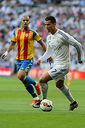 09.05.2015, Estadio Santiago Bernabeu, Madrid, ESP, Primera Division, Real Madrid vs FC Valencia, 36. Runde, im Bild Real Madrid&acute;s Cristiano Ronaldo and Valencia's Sofiane Feghouli // during the Spanish Primera Division 36th round match between Real Madrid CF and Valencia FC at the Estadio Santiago Bernabeu in Madrid, Spain on 2015/05/09. EXPA Pictures &copy; 2015, PhotoCredit: EXPA/ Alterphotos/ Luis Fernandez<br /> <br /> *****ATTENTION - OUT of ESP, SUI*****
