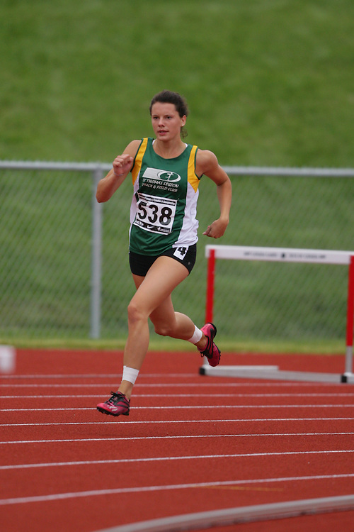 (Charlottetown, Prince Edward Island -- 20090718) Jenessa Olson of ST Thomas Legion Tfc competes in the 400m hurdles semifinals at the 2009 Canadian Junior Track & Field Championships at UPEI Alumni Canada Games Place on the campus of the University of Prince Edward Island, July 17-19, 2009.  Geoff Robins / Mundo Sport Images ..Mundo Sport Images has been contracted by Athletics Canada to provide images to the media.